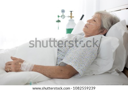 palliative care,  old asian patient sleep on white bed