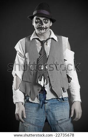 pallid deadman in rags  against dark background