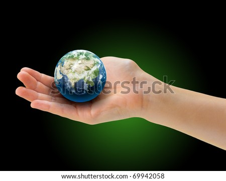 Palm of a hand holding realistic small globe symbolizing environmental care, facing Asia