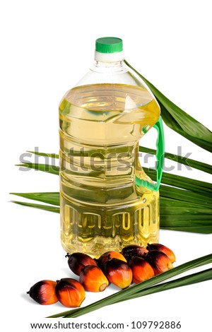 Palm Oil fruits with cooking oil isolated on white background, selective focus.