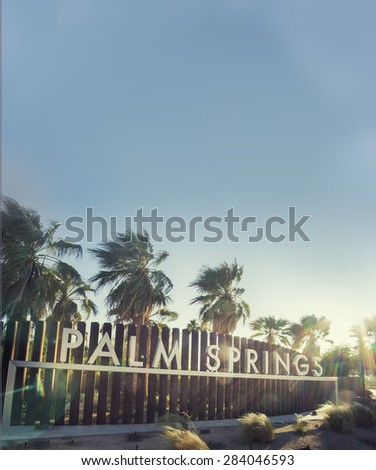 Palm Springs sign - epic sky and sun-flare copy space area