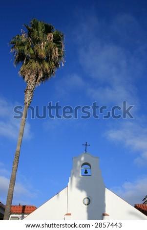 Palm tree next to a Spanish Mission in La Jolla, San Diego.