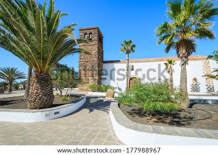 Palm tree square with church in La Oliva village, Fuerteventura, Canary Islands, Spain