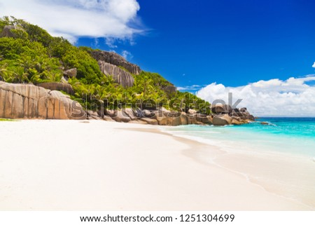 Palm trees on one of the best beaches of Seychelles