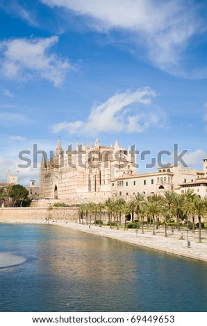 Palma de Mallorca; view over water feature; towards the cathedral La Seu; - stock photo