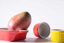 Palmer mango fruit and bowl on white background, Tropical fruit