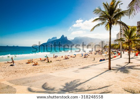 Palms and Two Brothers Mountain on Ipanema beach in Rio de Janeiro. Brazil.
