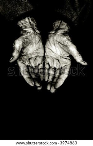 palms of a elderly woman, isolated on black copy-space