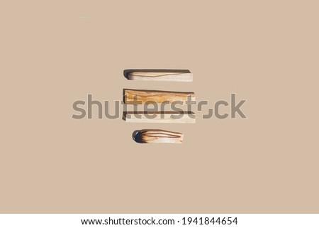 Palo santo holy wood sticks on beige background flat lay. Minimal spiritual practices concept Photo stock ©