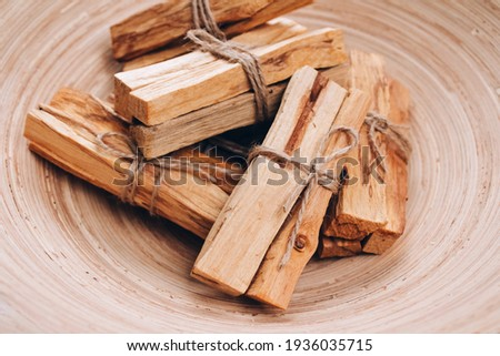Palo Santo tree sticks in wooden bowl - holy incense tree from Latin America. Meditation, mental health and personal fulfilment concept, selective focus Photo stock ©