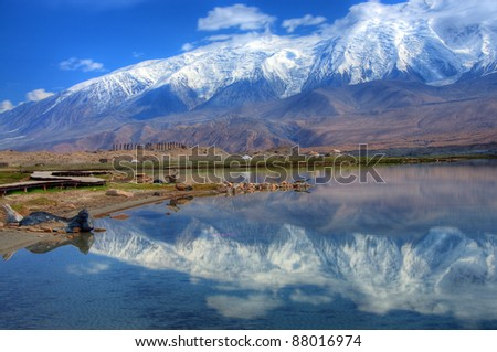 Pamir Mountains reflection on Karakuli Lake, Pamir Mountains, Xinjiang