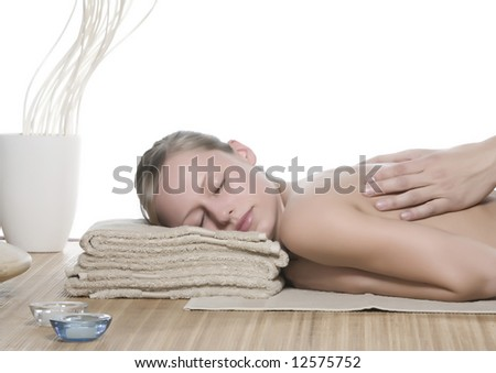 Pampered young woman with male hands doing a massage.