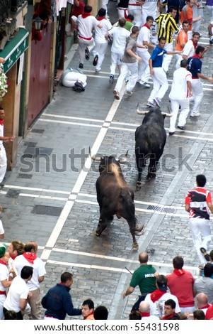 PAMPLONA-JULY 9:Bull running in the calle Estafeta. Fiesta de San Fermin, Pamplona, Navarra, Spain 9 July 2008 in Pamplona Spain