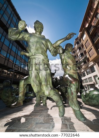 PAMPLONA, SPAIN - APRIL 1: The Statue of Encierros in Pamplona was created by Rafael Huerta in 1994 in commemoration of the internationally known Pamplona Bull Run, on April, 2010 in Pamplona, Spain