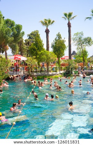 PAMUKKALE, TURKEY - MAY, 4: Tourists swim in Cleopatra's pools on May 4, 2012 in Pamukkale, Turkey. Cleopatra's pools made for queen Cleopatra nowadays become one of the most visited sight in Turkey.