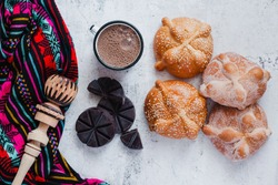 Pan de Muerto and hot chocolate, Mexican bread traditional for day of the Dead in Mexico