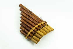 Pan flute instrument on white background.