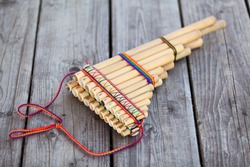 Pan flute (panpipes or syrinx) a musical instrument lying on square-edged flooring