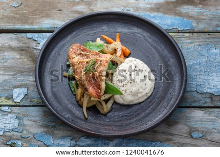 Pan fried ocean perch with sauteeed fennel and jerusalem artishoke puree, copy space #1240041676