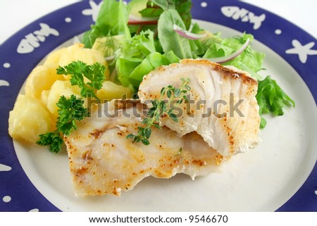Pan fried Pearl Perch with golden roasted potato pieces and salad.