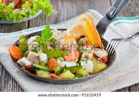 Pan fried redfish with mixed fresh vegetables