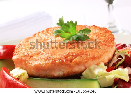Pan fried salmon served with vegetable salad