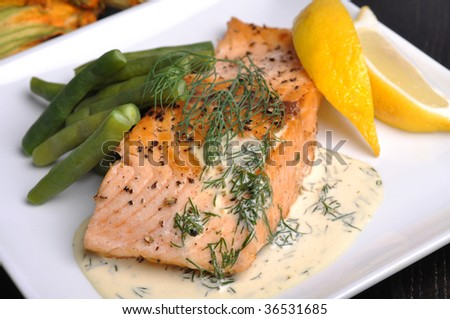 Pan-fried salmon steak with lemon dill sauce