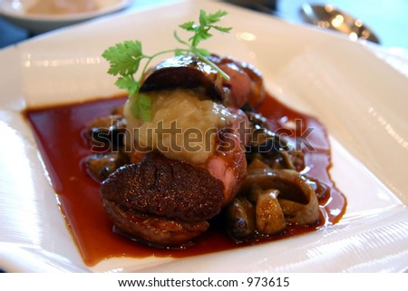 Pan fried slices of duck meat with succulent liver and mushrooms