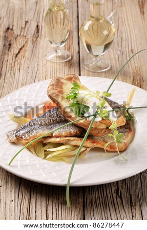Pan fried trout fillets and baked potato