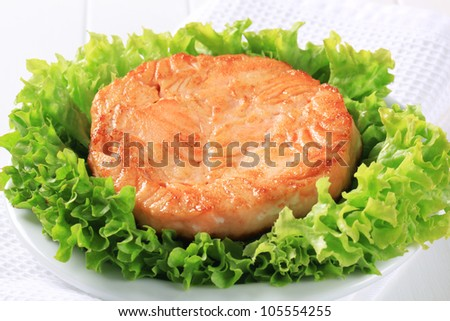 Pan seared fish cake served on lettuce