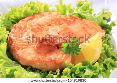 Pan seared fish patty served on lettuce