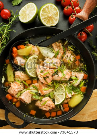 Pan with salmon soup and veggies. Viewed from above.