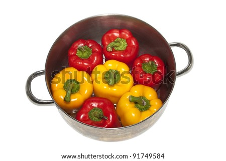 pan with stuffed peppers isolated on white