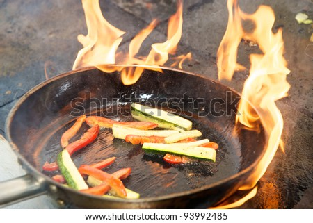 pan with the vegetables on the fire
