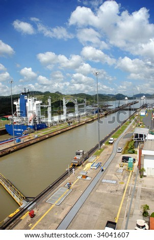 Panama Canal with a large container ship full of cargo in the background.