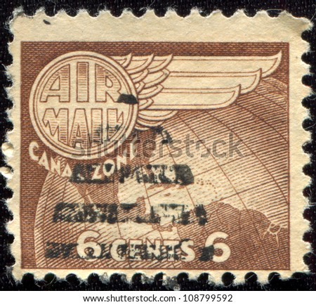 PANAMA CANAL ZONE- CIRCA 1951: A stamp printed in Panama Canal Zone shows wing and map of central America, circa 1951