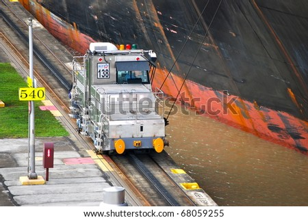 PANAMA - OCTOBER 6. In July 2009, the Panama Canal Authority awarded contracts to a consortium of companies to build six new locks by 2015. Locomotive towing a ship at Balboa. October 6, 2010, Panama