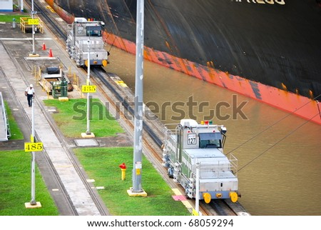 PANAMA - OCTOBER 6. In July 2009, the Panama Canal Authority awarded contracts to a consortium of companies to build six new locks by 2015. Locomotives towing a ship at Balboa. October 6 2010, Panama