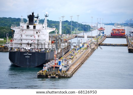PANAMA OCTOBER 6 In July 2009 the Panama Canal Authority awarded contracts to a consortium of companies to build six new locks by 2015 Locomotive towing a ship at Balboa October 6 2010 Panama