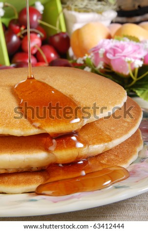 Pancake and some sweet honey - stock photo