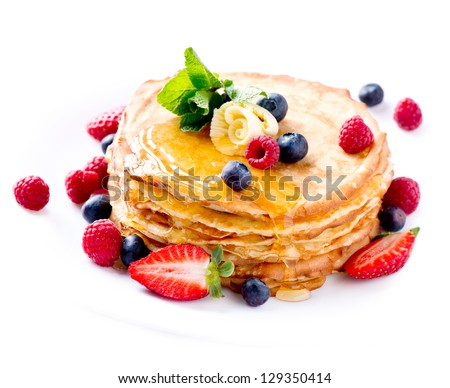 Pancake Crepes With Berries Pancakes stack with Strawberry Raspberry Blueberry and Syrupe isolated on a White Background