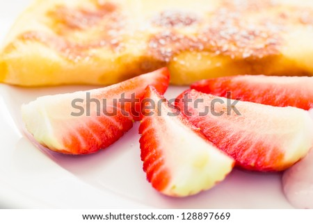 pancake with fresh strawberries sprinkled with sugar and ricotta