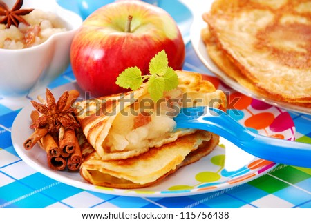 pancake with homemade apple`s preserves and raisins for child