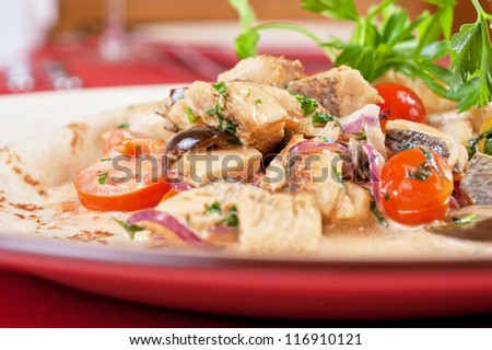 pancake with peled fish, different vegetables and sauce