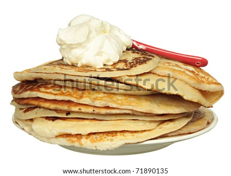 Pancakes and bowl with sour cream isolated on a white background