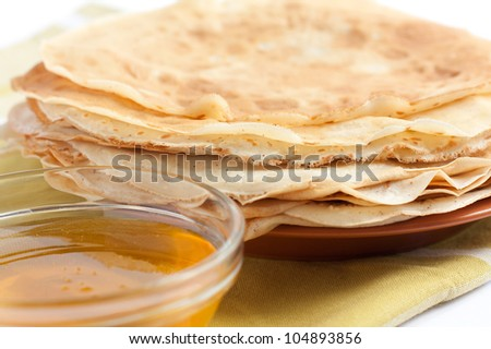 Pancakes and honey - a sweet dessert. Delicious meal