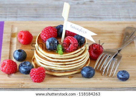 Pancakes for breakfast with berries and maple syrup