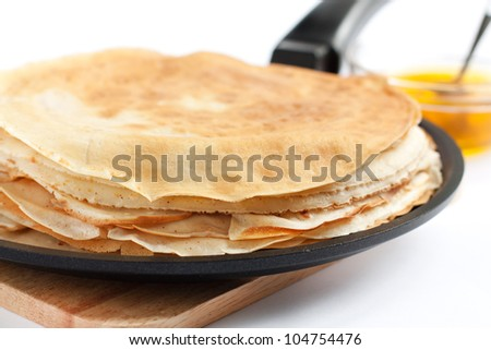 Pancakes in a frying pan. Fresh, delicious dessert