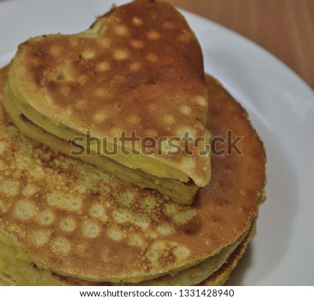 Pancakes in a shape of heart #1331428940