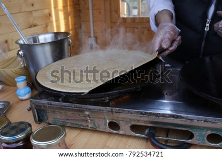 Pancakes - Palachinka, Palatschinke or palacsinta is a thin crepe - variety of pancake. Palatschinke are thin pancakes similar to the French crepes. Pictures through steam from pancakes.
